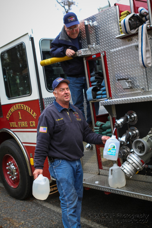 Firefighter Jim McAleer and Chief Joe Mecsey III deliver water to well owners on New Village rd in the aftermath of hurricane Sandy