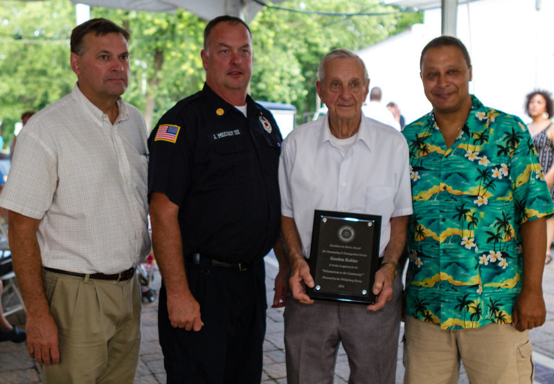 Gordon Kobler, Greenwich Twp., NJ displays his 2012 award from Phillipsburg Rotary President Bob Gould (L) at a ceremony on Sunday afternoon at the Ole Town Festival. Also present Joe Mecsey, III (Stewartsville Fire Chief) and Dan Perez (Greenwich Twp. Committee).
