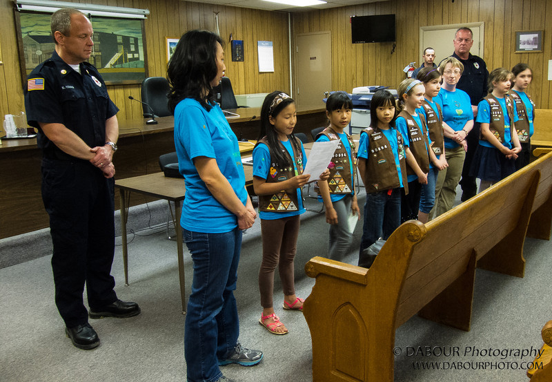Girl Scout Brownie Troop #90694 of Stewartsville, NJ visits the Stewartsville Vol. Fire Company to read a letter of appreciation. Photo by | DAVE DABOUR