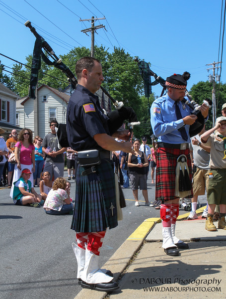 Scott Ferguson and Sean VanAssen play bag pipes at the greenwich Twp. Memorial Day Parade and service. E