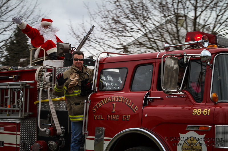 Members of the Stewartsville Vol. Fire Co. take Santa on an early visit to the township.
