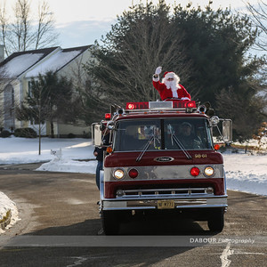 Members of the Stewartsville Vol. Fire Co help Santa out on an early visit to Greenwich Twp NJ on Saturday. Photo by | DAVE DABOUR