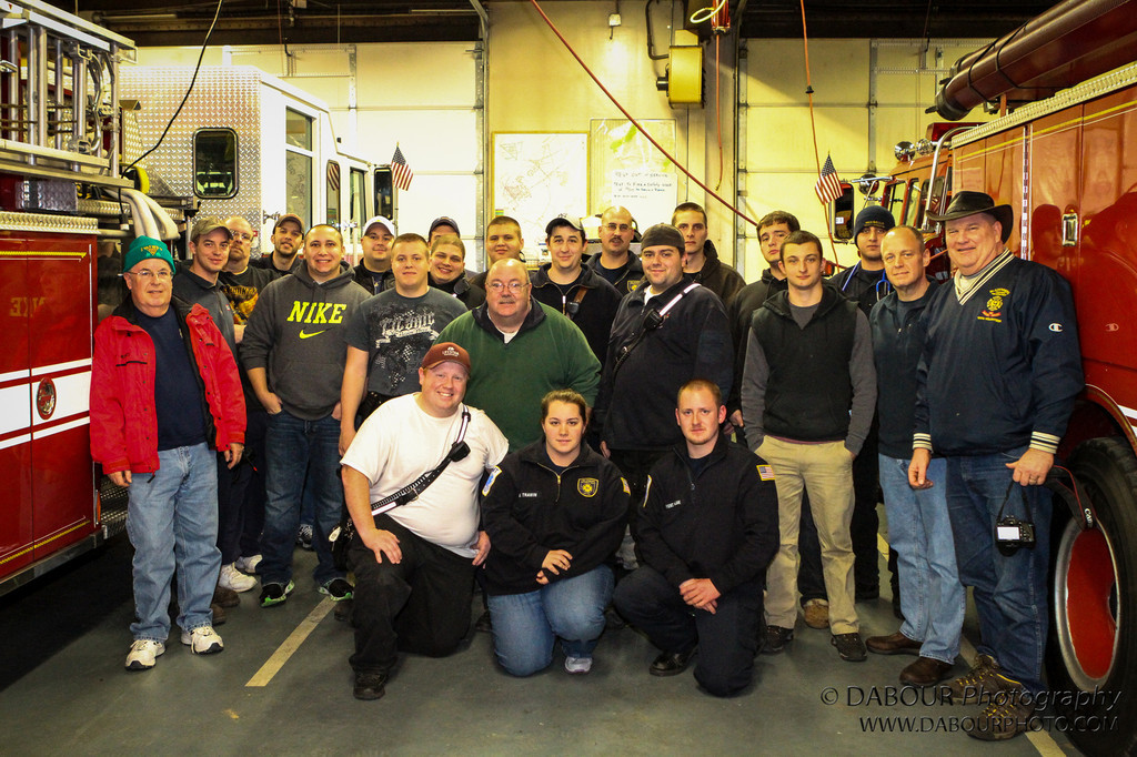 Firefighters from Stewartsville and surrounding companies gather inside the department before heading out to welcome Ryan Home