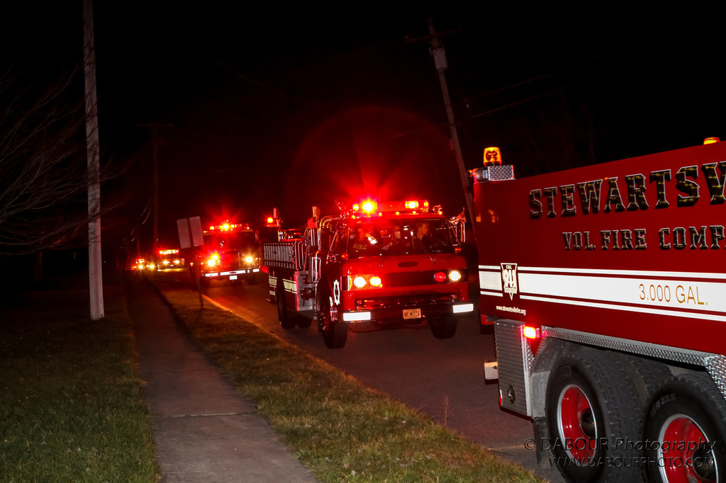 Members of Stewartsville Fire campany and surrounding first responders line up to escort Ryan Kanyuck home