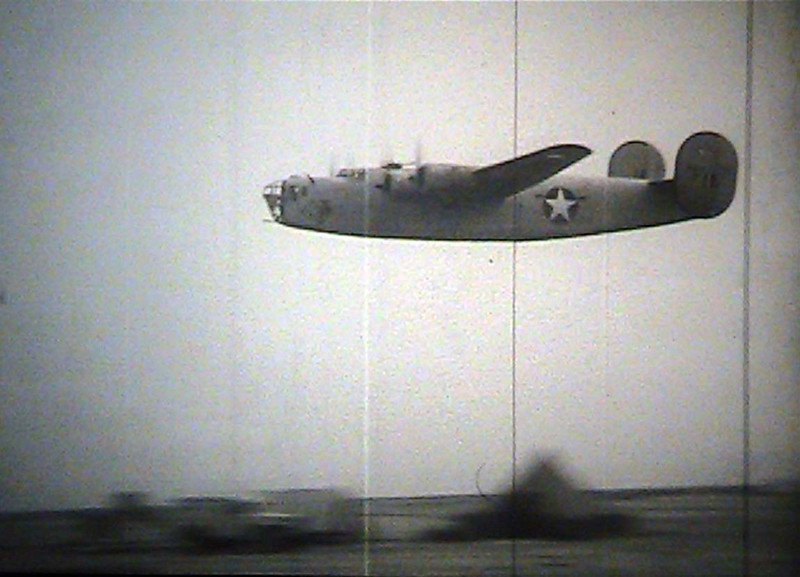From the film: CAPT. RICKENBACKER VISITS 98TH BOMB[ARDMENT] GROUP, LEYTE AND LIBYA <br /> ARC Identifier 3026 / Local Identifier 18-CS-169 <br /> Moving Images from the War Department. Army Air Forces. (06/20/1941 - 09/26/1947)<br /> Motion Picture, Sound, and Video Records Section, Special Media Archives Services Division, College Park, MD <br /> Item from Record Group 18: Records of the Army Air Forces, ca. 1902 - 1964