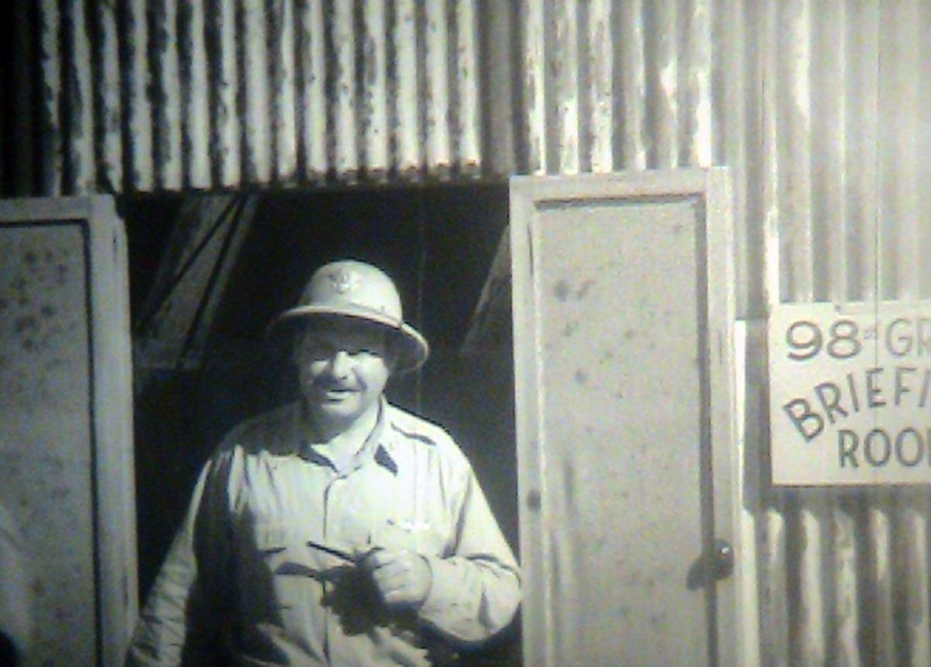 98th operating our of Northern Africa, 1943 -- Col. Kane. A still shot from the film: <br /> ADVANCE OF 98TH BOMBER [I.E., BOMBARDMENT] GROUP, NORTH AFRICA <br /> <br /> ARC Identifier 3085 / Local Identifier 18-CS-246 <br /> <br /> Moving Images from the War Department. Army Air Forces. (06/20/1941 - 09/26/1947)<br /> <br /> Motion Picture, Sound, and Video Records Section, Special Media Archives Services Division, College Park, MD <br /> <br /> Item from Record Group 18: Records of the Army Air Forces, ca. 1902 - 1964