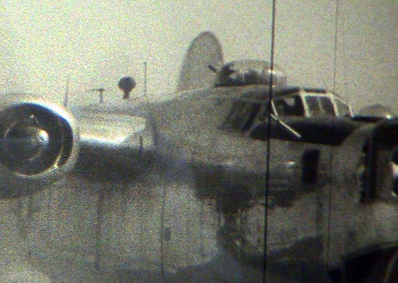 A still taken from the film as 526-L lands and rolls to a stop. I zoomed in on the cockpit -- and maybe I am just seeing what I want to see, but I believe I have captured a frame of my grandfather as co-pilot.