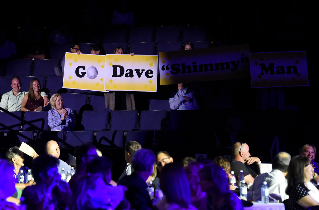 . BROOMFIELD, CO - SEPTEMBER 20, 2018: The crowd holds a sign for David Shinneman and Stephanie McGill during the Ninth Annual Dancing with the Broomfield Stars fundraiser hosted by the Broomfield Community Foundation on Thursday at the 1st Bank Center in Broomfield. For more photos of the event go to dailycamera.com (Photo by Jeremy Papasso/Staff Photographer)
