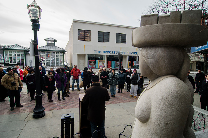 Residents and local leaders come together, in front of 'The Immigrant' statue, for a press conference to condemn the Trump administration executive orders against immigrants and refugees on Friday, February 3, 2017 in downtown Fitchburg. Residents and local leaders gathered to call on allies to support the Safe Communities Act, an act that would ensure local police resources for fighting crime, not enforcing federal immigration law and pledge no state support for a Muslim registry. SENTINEL & ENTERPRISE / Ashley Green