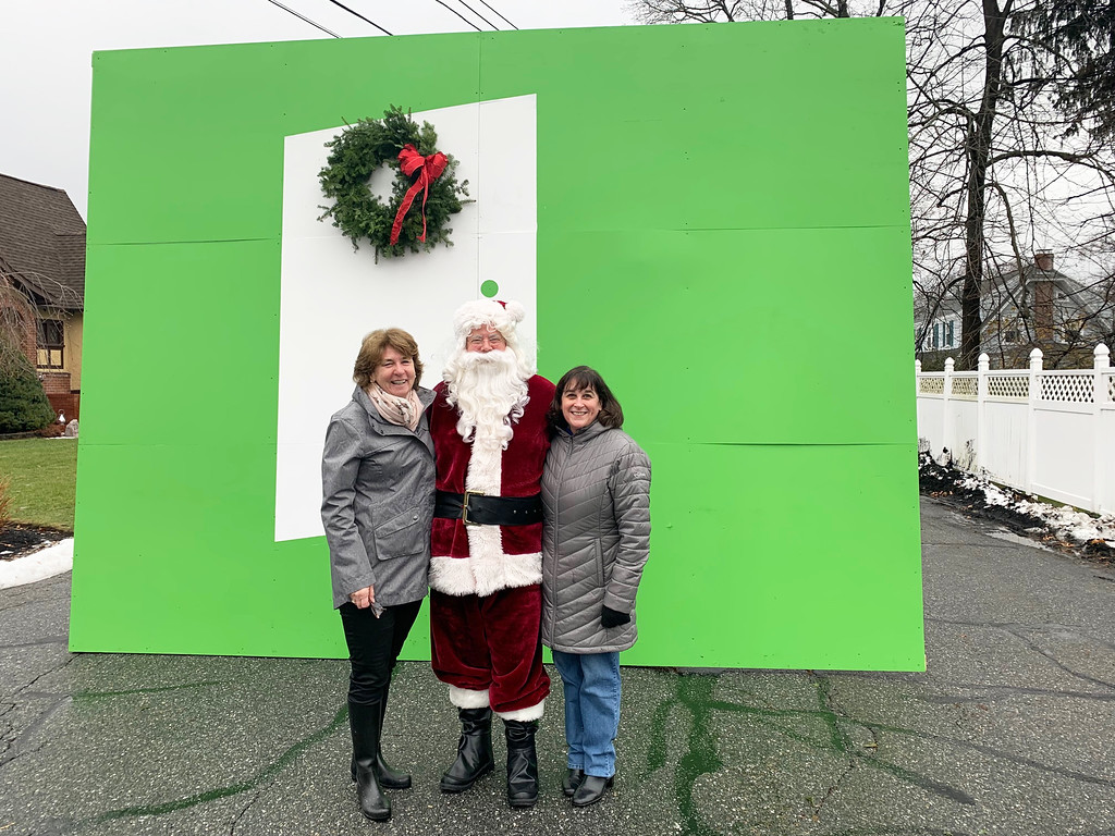 . From left, Trish O�Donnell, Santa and Pat Witts of Dracut