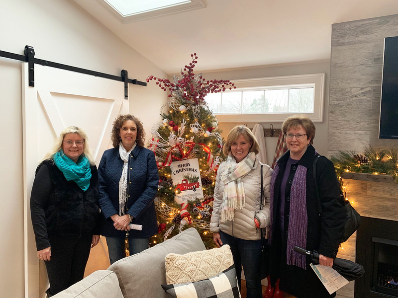 Touring the James & Edith Leighton House are, from left, Maura Sorensen and Linda Gilbride of Tyngsboro, Meghan Coughlin of Lowell and Kathy McDonough of Methuen.