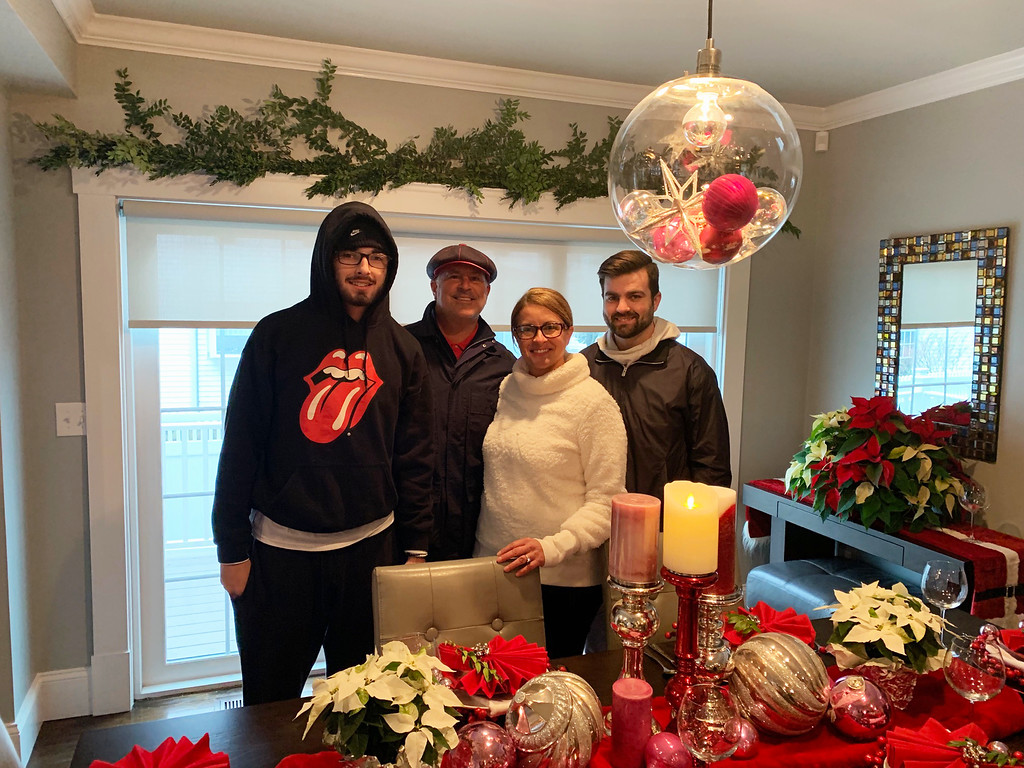 . At the Norman B. Reed House are, from left, Bret Edwards, owners Dean Emerson and Erin Edwards, and Kyle Edwards, all of Lowell