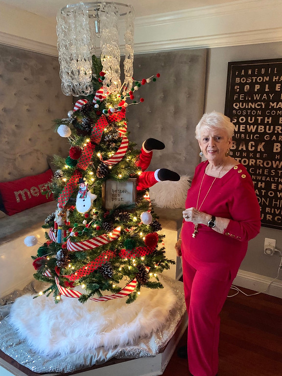 . Carole Daly of Lowell, mother of James & Edith Leighton House owner Erin McMahon, enjoys the Christmas tree.