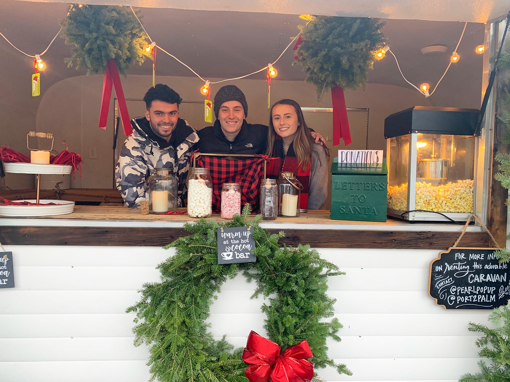 . From left at the McMahon house (which featured an outside trailer serving popcorn and hot chocolate) are Matthew O�Neil, Joe Ferry and Lyndsey McMahon, all of Lowell.