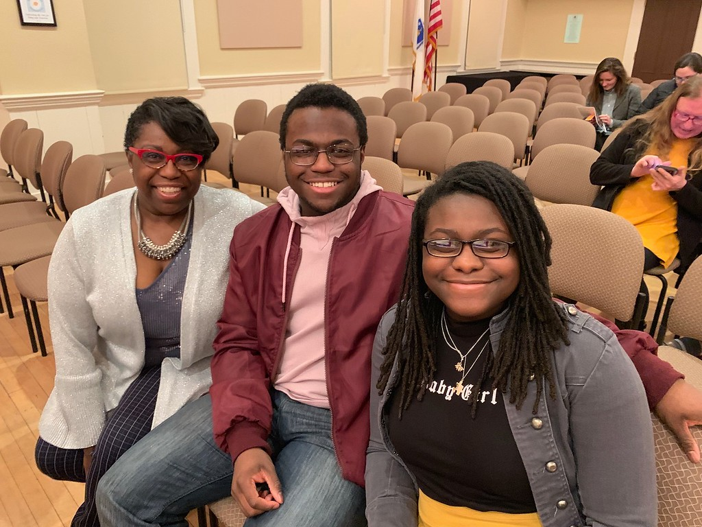 . From left, Ahni, Seth and Sydney Malachi, all of Pembroke and all fans of Jordan Malachi, director of �And She Was Melancholy�