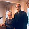 Society President Ellen Dobi and the Rev. Tom Chininis, both of Lowell