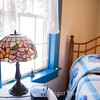 Stained Glass Lamp and Blue Quilt Room
