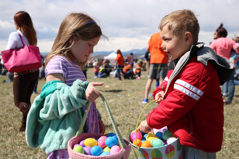 "Rose and Toby Debruycker, ages 6 and 5 respectively, compare Easter egg hauls after hunting for eggs at ""A. Day of Kindness"" in Berthoud on Saturday. Their little brother Noah, 20 months, also participated."