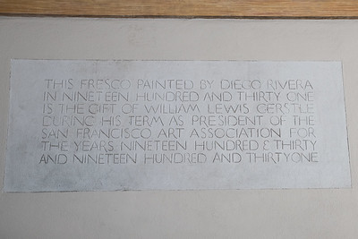 Inscribed within the wall below the mural.
