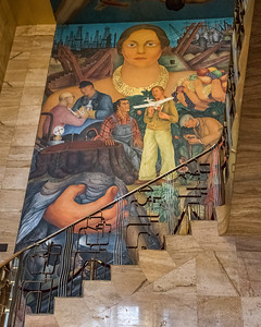 """Allegory of California"" fresco in the grand stairway of the City Club. Featuring ""Califa"", the sacred spirit of California, 1931. Her hands grasp agriculture and mining, both powerful economic forces of the state."