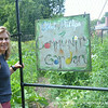Instructor Elizabeth Poland manages the Urban Garden Initiative with students.