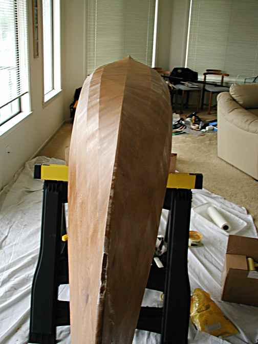 Roll, Roll, Roll your boat....Rolling the epoxy over the cloth flattens it against the hull.  You want it to be COMPLETELY flat so no air pockets will form, but if your keel construction is less than perfect well, now's the time when it will show up.