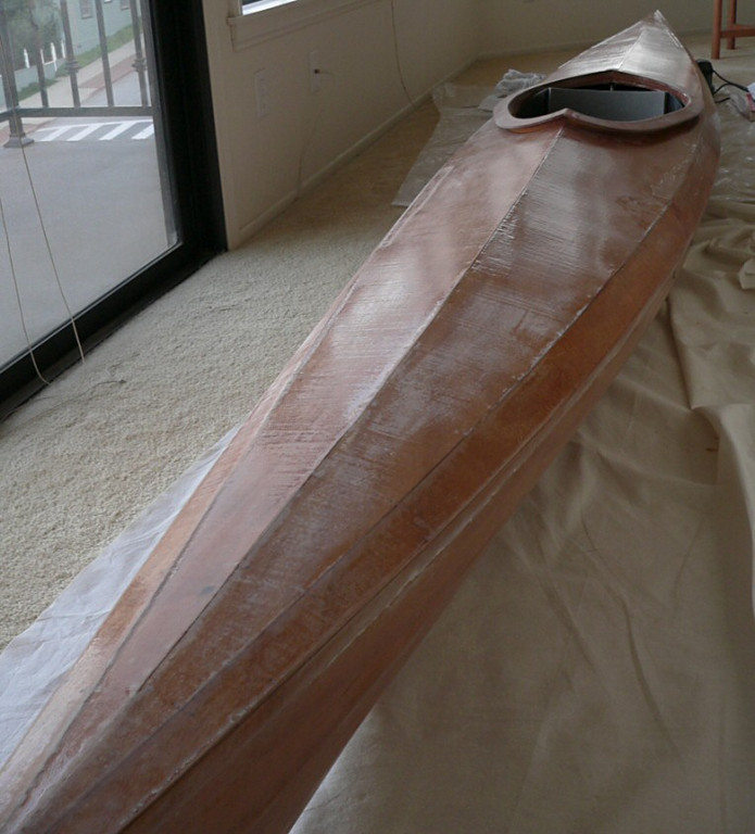 After installing the seat and foot bracings, it's time to sand down all that epoxy that was so laboriously put on.  I'm using a random orbital sander but you must be careful as you don't want to sand so much off that you cut into the fiberglass weave. It's a tricky business...It's now January 24, 2005.
