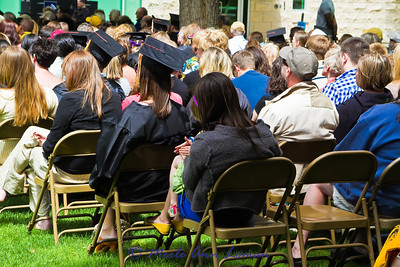 this child on the lap of an adult was so good during the ceremony. All you can see in this photo is her hands and a foot.