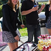 Jessa is wondering why I am taking a photo of her cutting the cake. I am too.