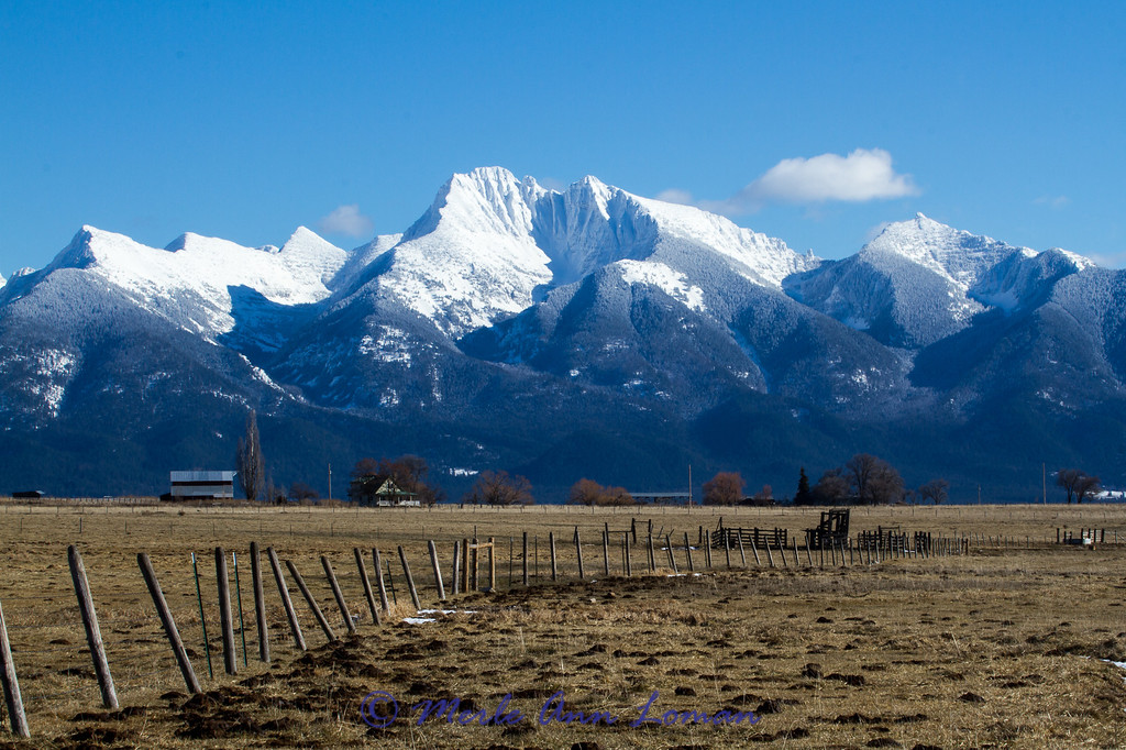 Mission Mountains. Taken southwest of Pablo, Montana from a gravel road. The Sheep's Head is the mountain peak in the very far right of the photo.