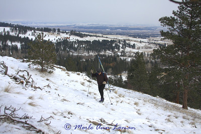 Hiking up a sparse hill, you can put skins on when the snow is deeper.