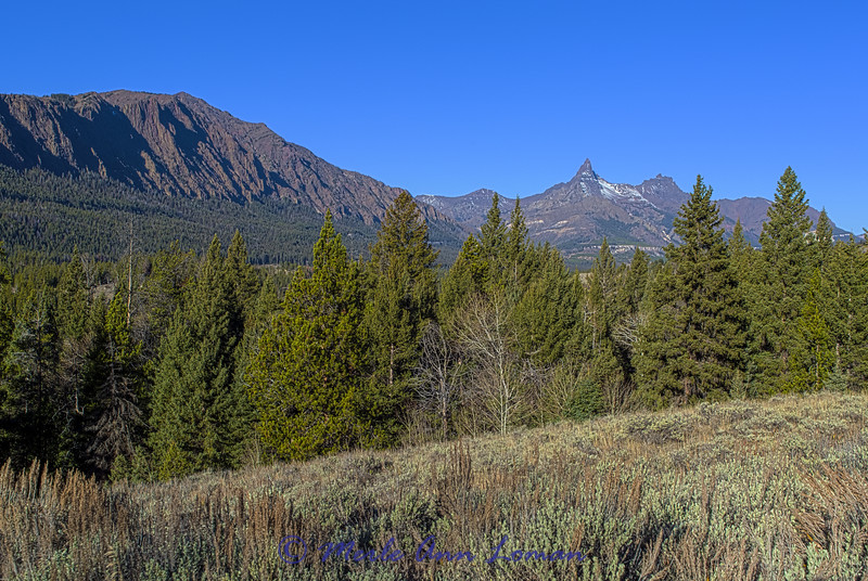 Pilot (spire-like peak) and Index peak in the Beartooth Mountains. Taken near the junction of Chief Joseph Hwy and Beartooth Hwy.