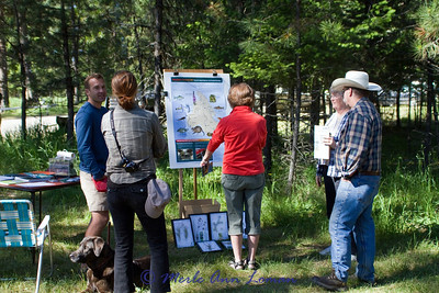 Information stations were set up at the Holland Lake boat launch site where the workshop was taking place