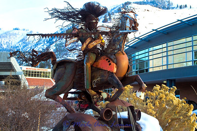 """Iron Horse sculpture at the University of Montana parking lot, by Jay Laber, titled """"Charging Forward""""."""