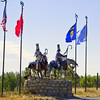Alternate view of the warriors. Not a great photo, but I wanted to show all the flags. US, Canada, Montana, and Blackfeet Nation (l-r)