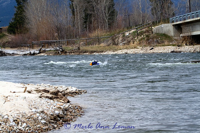 Alan has canoed to a gravel bar upstream and is swimming down current to the boat again to work on attaching ropes.