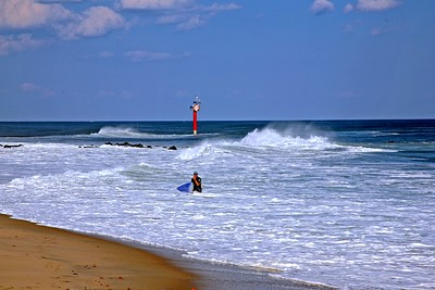 Surfer enjoys an Autumn Day at the Jersey Shore.