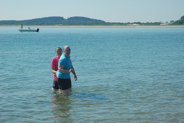 7/31/2011 - Sandy Point Destination point for a lovely 27 mi round trip from Deer Island Debbie and Judy take a dip.
