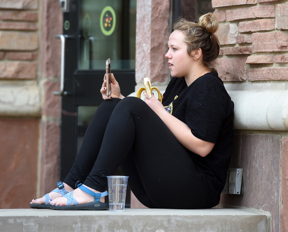 . Nora Lazerus takes some Facetime with her mother outside the Atlas Building on the University of Colorado campus on February 15, 2018. For more photos, go to dailycamera.com.  Cliff Grassmick  Photographer  February 15, 2018