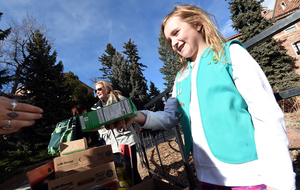 . Taylor Whitehall, right, and her mother. Jessica, sell Girl Scout Cookies on the University of Colorado campus on February 15, 2018. For more photos, go to dailycamera.com.  Cliff Grassmick  Photographer  February 15, 2018