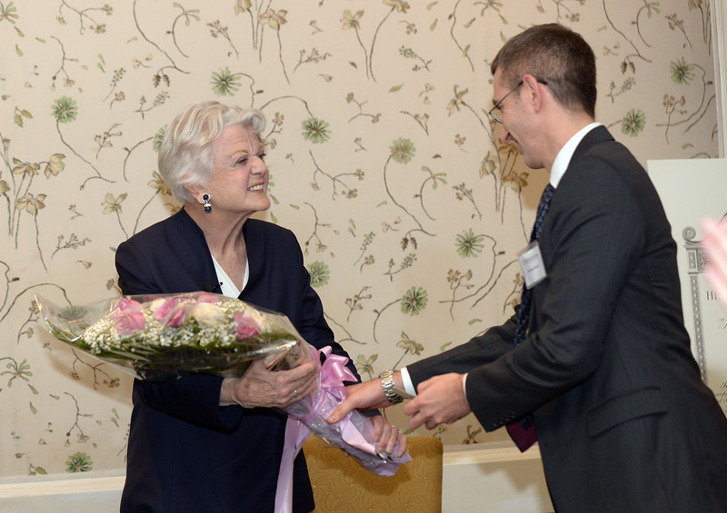 Dame Angela Lansbury receives a bouquet.