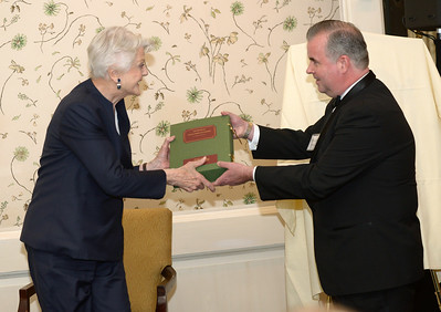 Dame Angela Lansbury receives her genealogy from NEHGS Editor-in-Chief Scott C. Steward.