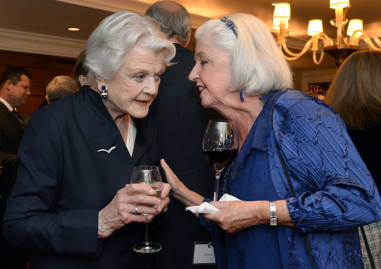 Angela Lansbury chats with a guest.