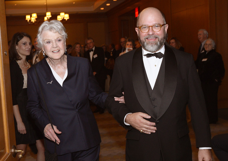 Guest of Honor Dame Angela Lansbury, DBE entering the banquet room on the arm of President and CEO Brenton Simons
