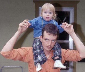 My brother Michael in his early 20's with his firstborn Renee on his shoulders.