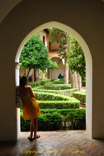 Rachel in the archway to a beautiful garden, Alhambra, Grenada, Spain