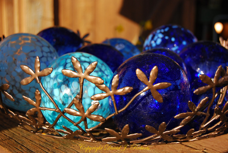 Glass balls in a brass basket