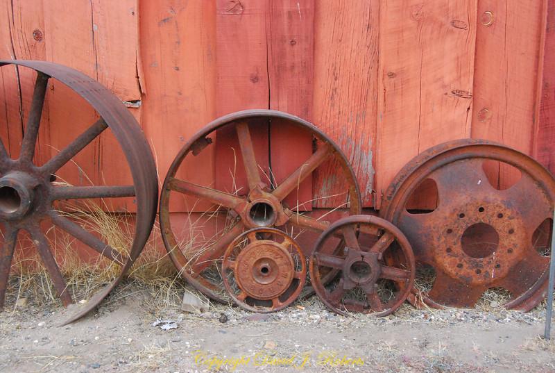 Old wheels and pulleys, Meadow Creek Ranch, Mariposa, California