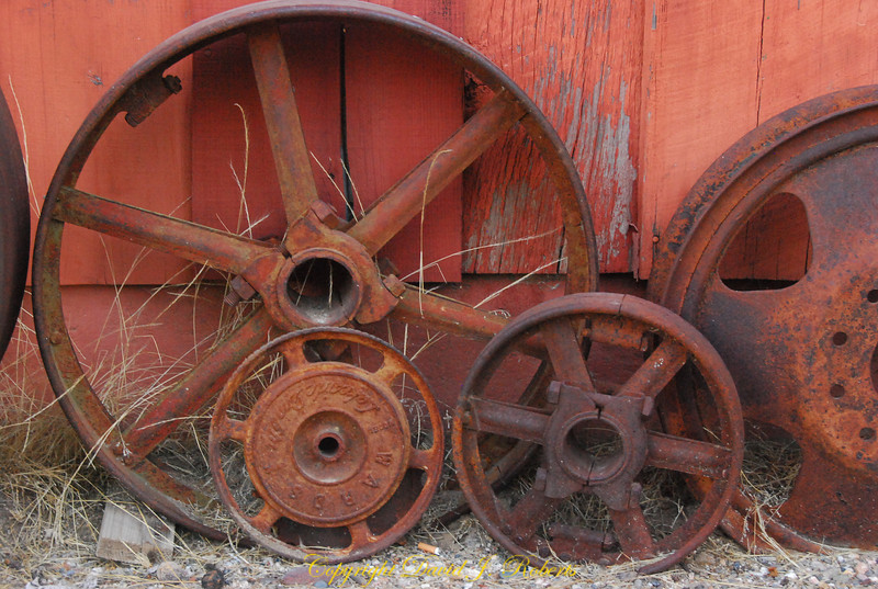 Old wheels and pulleys, Meadow Creek Ranch, Mariposa, California