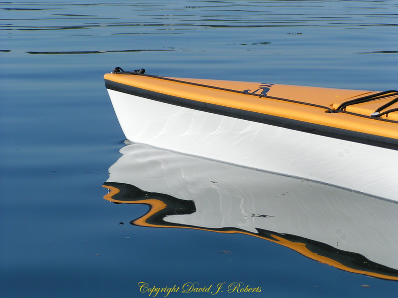 Kayak and reflection